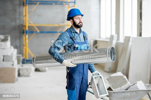 895571294 istock photo Builder with pipe indoors 938084370