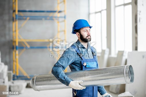 895571294 istock photo Builder with pipe indoors 938084406