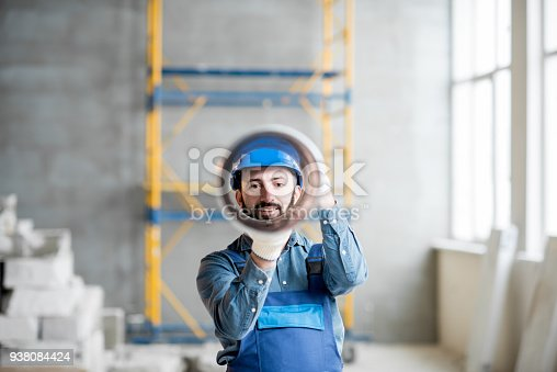 895571294 istock photo Builder with ventilation pipe 938084424
