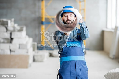 895571294 istock photo Builder with ventilation pipe 938084456