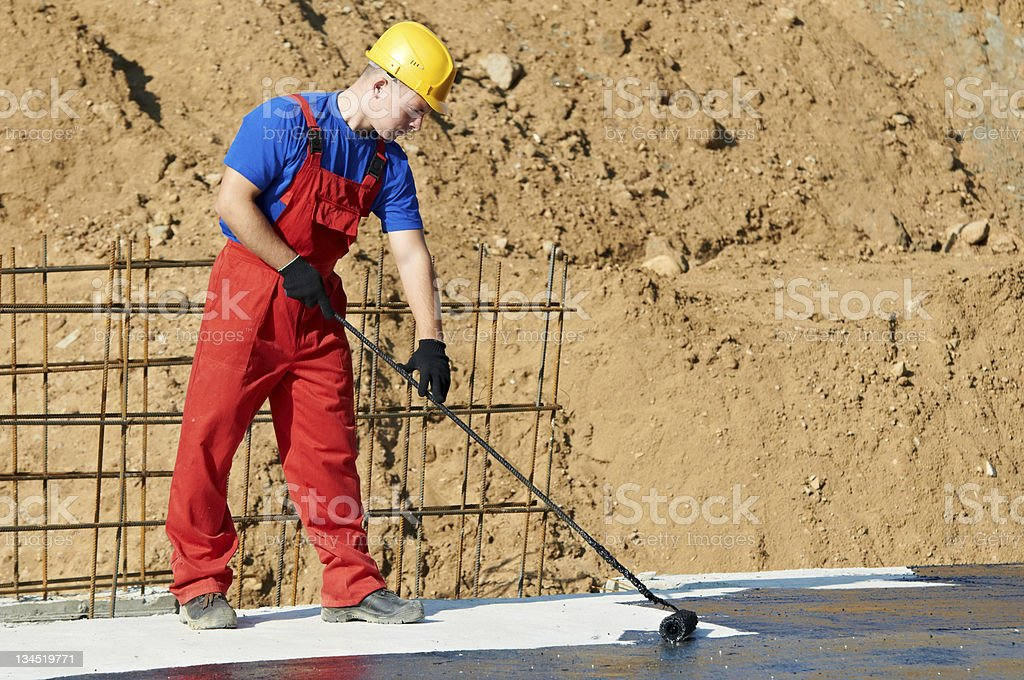 builder worker at roof insulation work stock photo