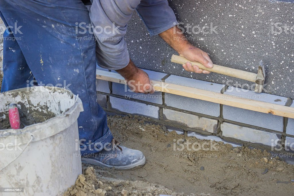 builder worker installing insulation layer stock photo