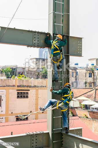 istock Builder workers in safety protective assemble metal construction frame 487724776