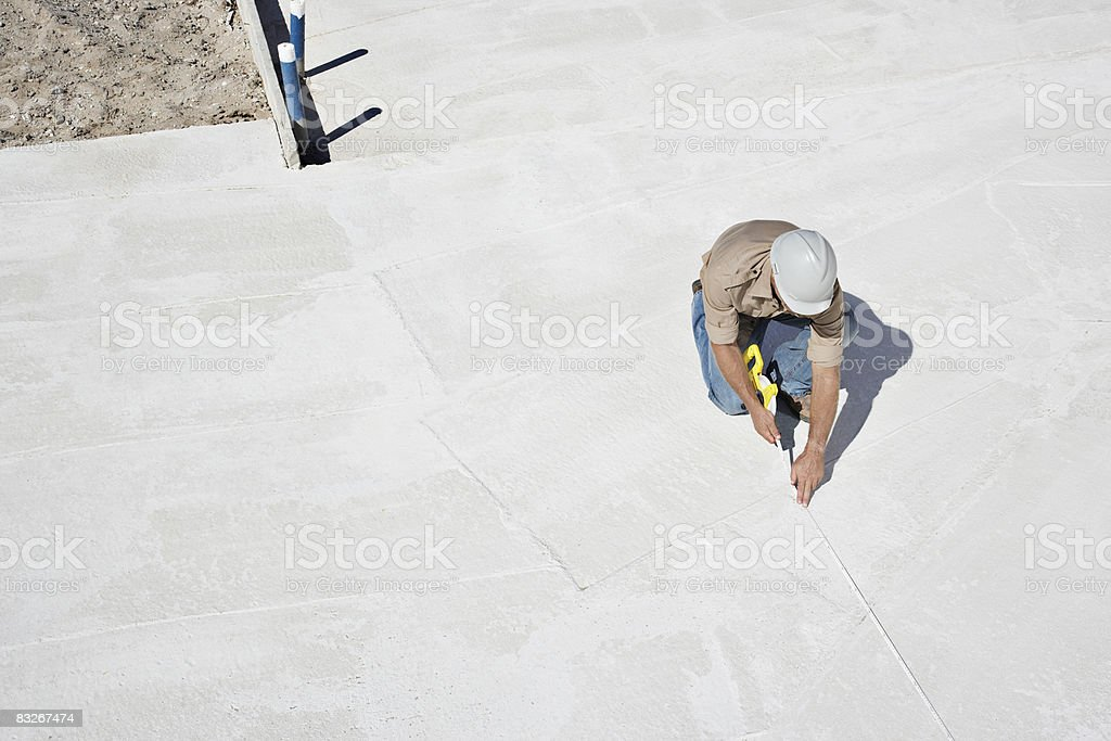 Builder working at construction site royalty-free stock photo