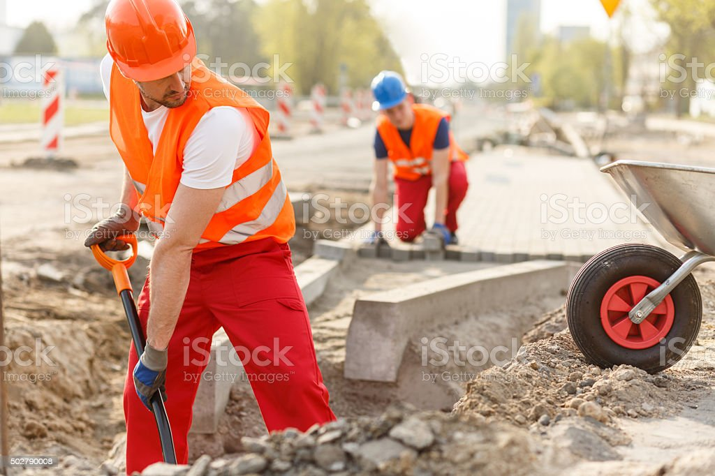 Builders and paving stock photo