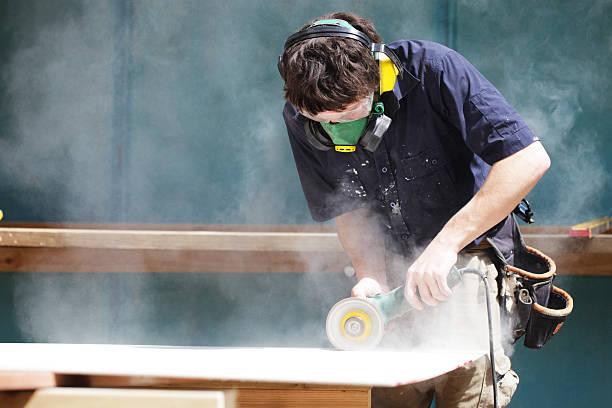 Builders apprentice stock photo