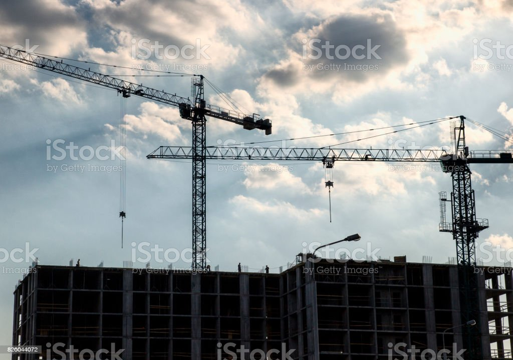 Builders are working on the construction site stock photo