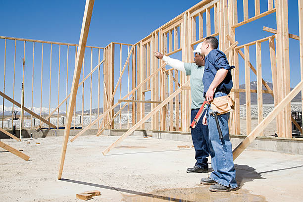 Builders on construction site stock photo