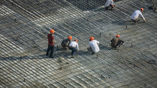 Builders reinforce the area for pouring concrete stock photo