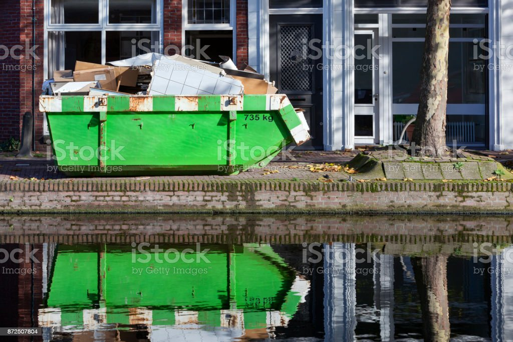 Builders skip near a canal stock photo