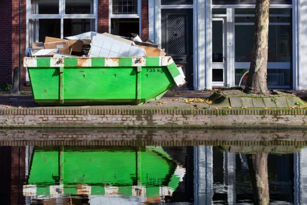 Builders skip near a canal stock photo