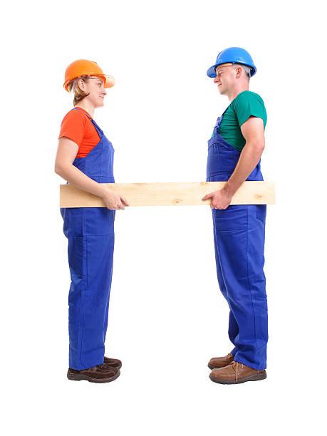 builders mit plank - jumpsuit blau stock-fotos und bilder