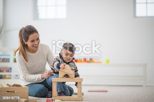istock Building a Block Tower 509416778