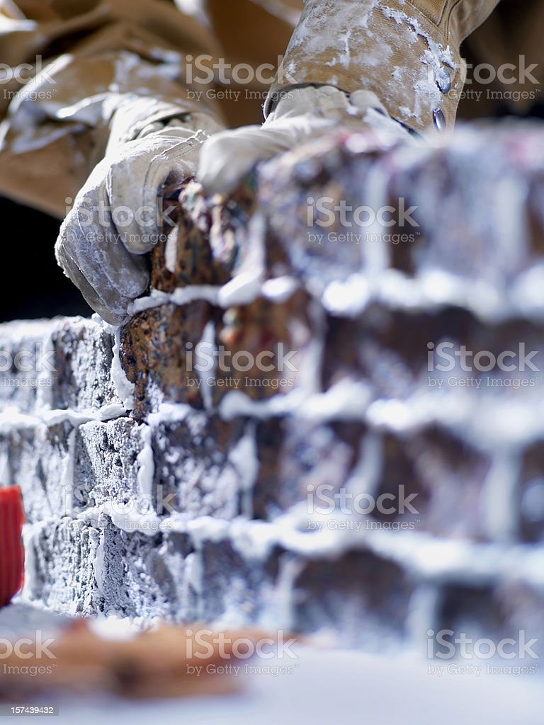 Building a Brick wall of Left Over Fruit Cake royalty-free stock photo