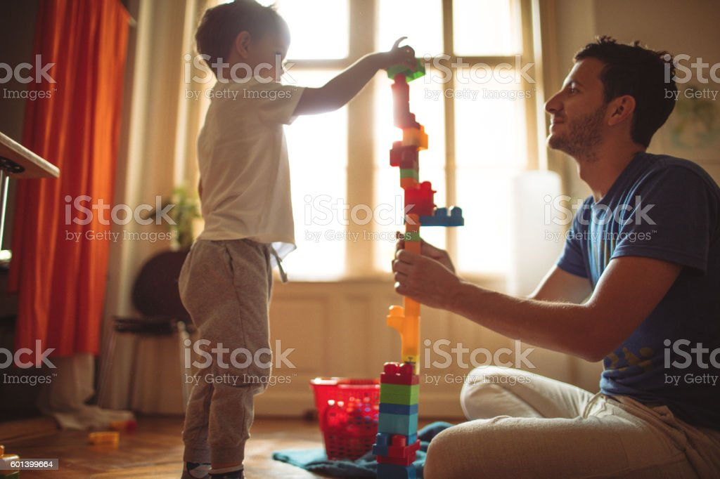 Building a castle with my dad stock photo