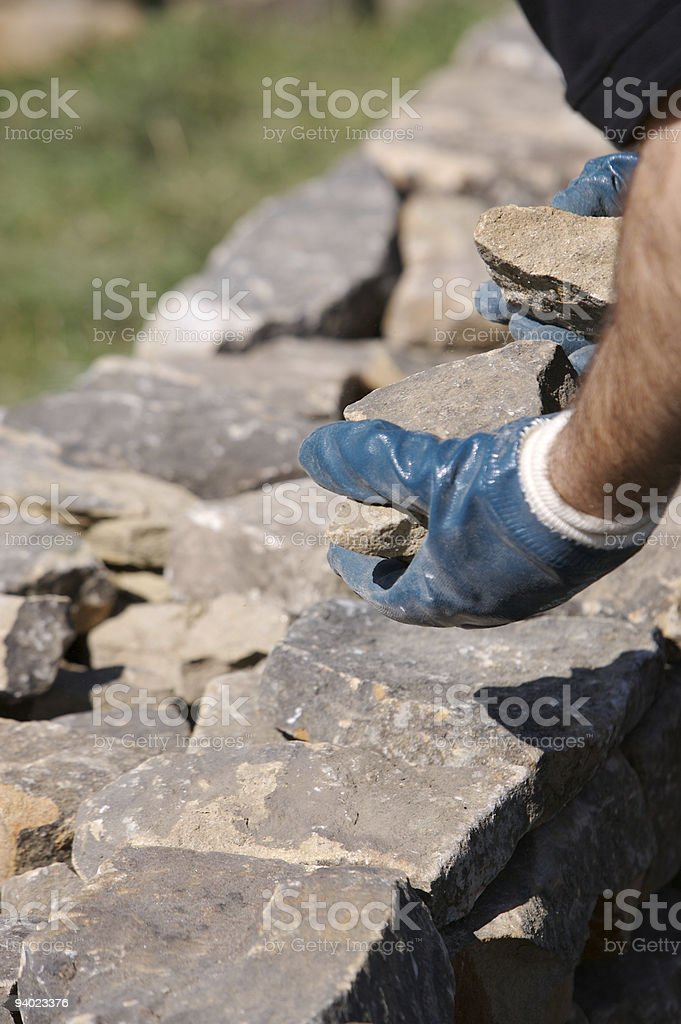 Building a Dry Stone Wall royalty-free stock photo