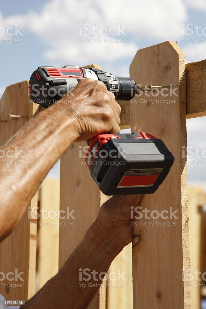 Building a Fence Series - Using Power Drill stock photo