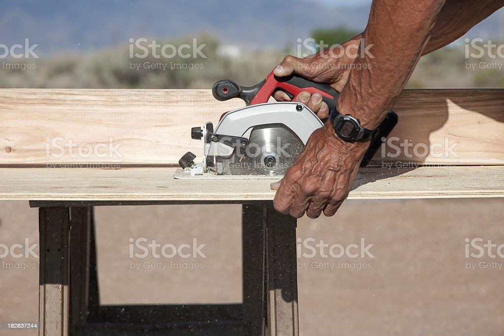 Building A Garden Box Series - Using Power Saw royalty-free stock photo