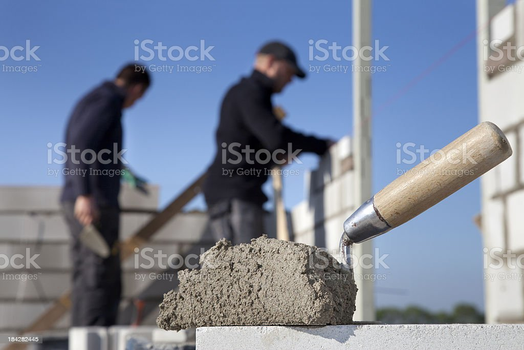 Building a house. Bricklayer at work. stock photo
