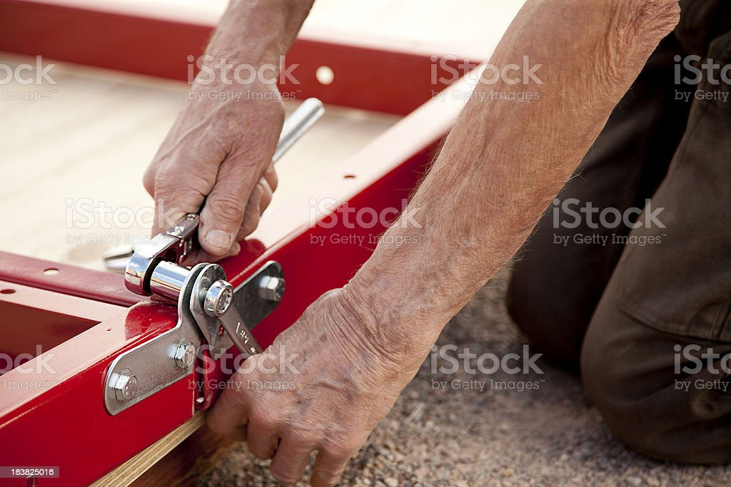 Building a Kit Trailer Series - Tightening Bolt on Hinge stock photo