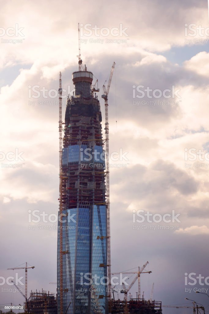 Building a large office building using cranes royalty-free stock photo