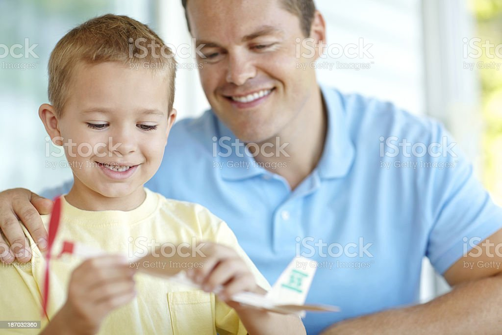 Building a model plane with dad royalty-free stock photo