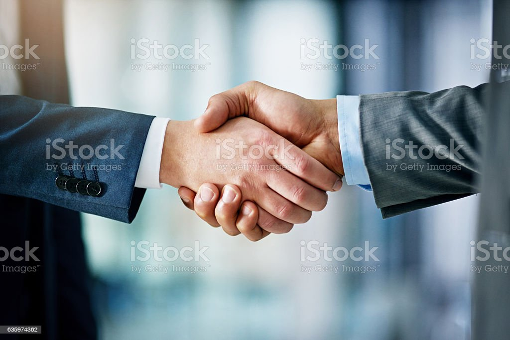 Building a network towards success Closeup shot of two businessmen shaking hands in an office Adult Stock Photo