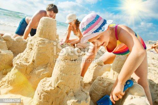 512726470 istock photo Building a sand castle 155384256