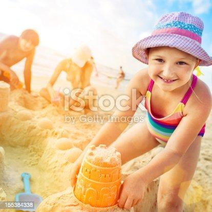 509423868 istock photo Building a sand castle 155384338