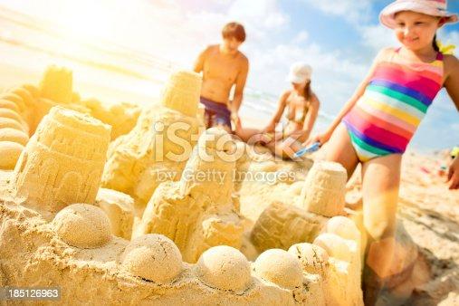 509423868 istock photo Building a sand castle 185126963
