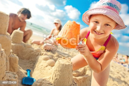 512726470 istock photo Building a sand castle 469125439