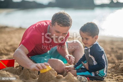 605742160 istock photo Building a Sandcastle on the Beach Together 501579688