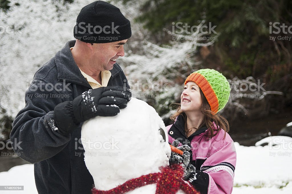 Building a Snowman royalty-free stock photo