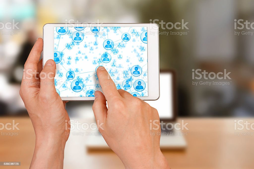 Building a social network on tablet inside coffe shop royalty-free stock photo