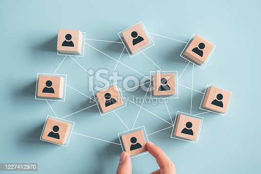 istock Building a strong team, Wooden blocks with people icon on pink background, Human resources and management concept. 1227412970