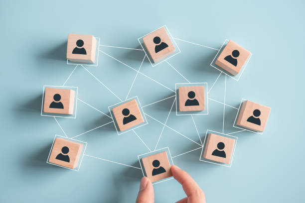 Building a strong team, Wooden blocks with people icon on pink background, Human resources and management concept. Building a strong team, Wooden blocks with people icon on pink background, Human resources and management concept. collaboration stock pictures, royalty-free photos & images