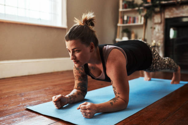 building a stronger core - exercise at home stock pictures, royalty-free photos & images