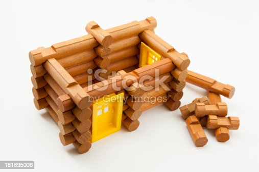 Wooden log toy parts of a house without a roof