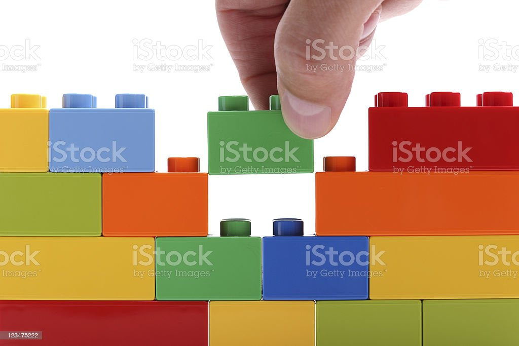 Building a wall from blocks stock photo