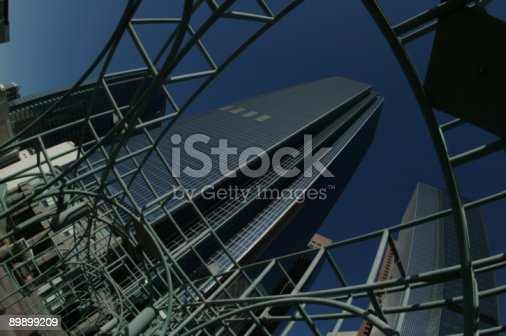 Down town LA building shot up through a walk way trellis. Shot on Canon 1Ds with super wide angle.