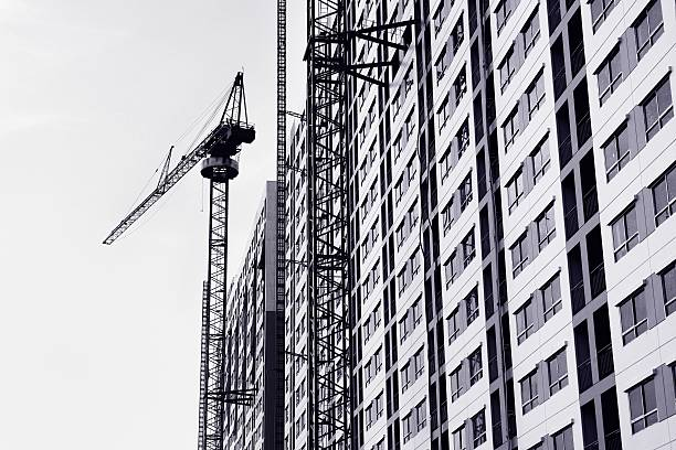 Building and cranes under construction stock photo