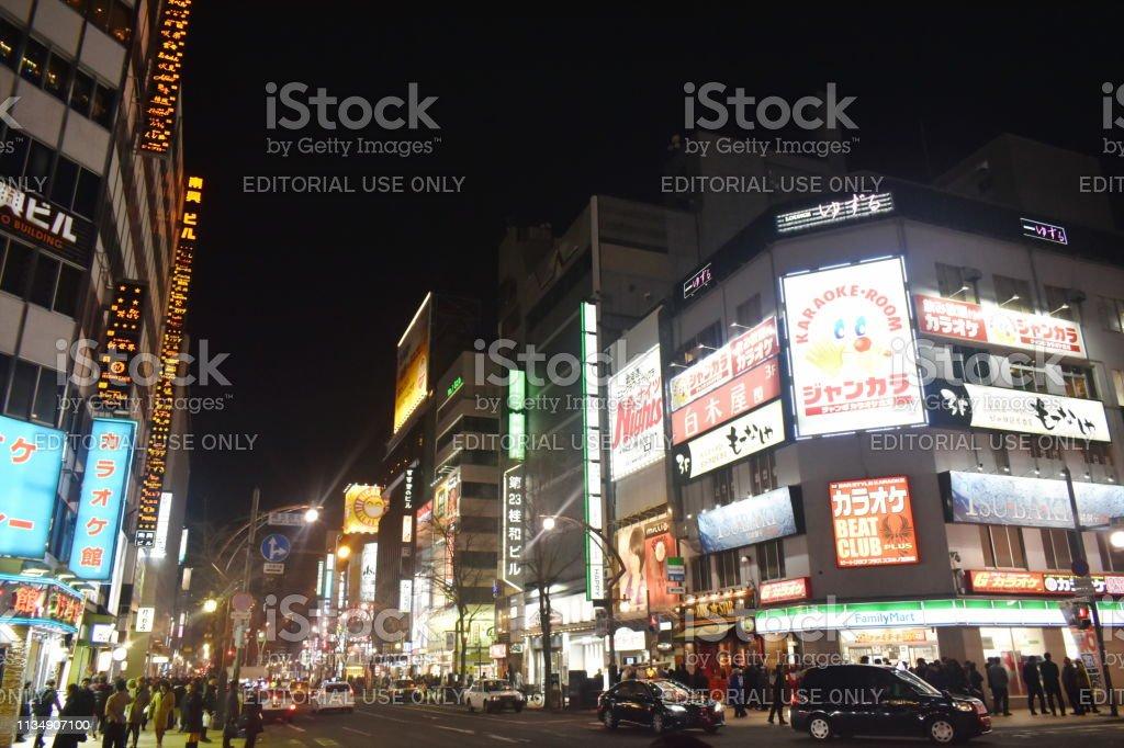building and LED advertising banner on Tanukikoji walking street in...