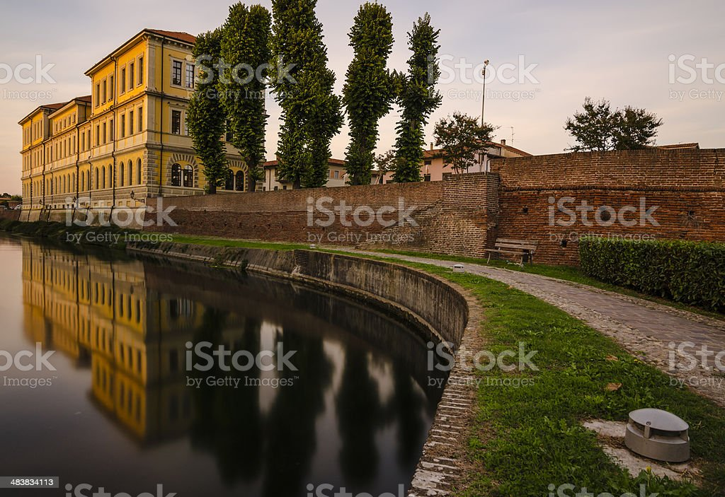 building and plants reflection in the medieval city of Soncino royalty-free stock photo