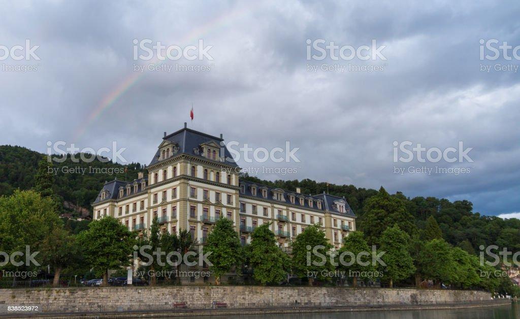 Building and rainbow stock photo