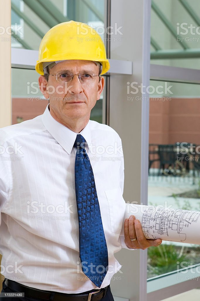 Building Architect with Blueprints royalty-free stock photo