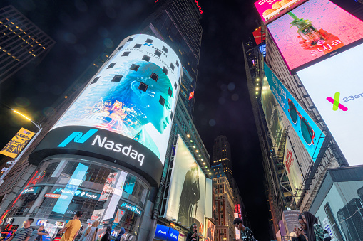 Night view of skyscrapers and NASDAQ building in Time Square on July 30, 2018 in New York, NY. Times Square is the most visited tourist attraction in the world.