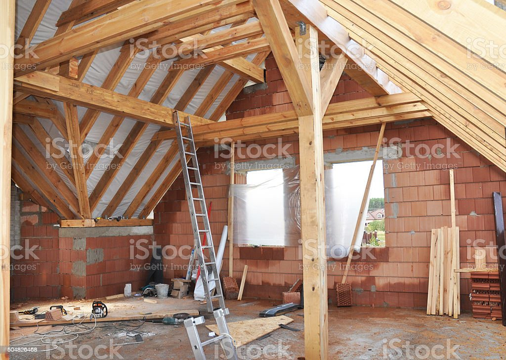 Building Attic Interior. Wooden Roof Frame House Construction. stock photo