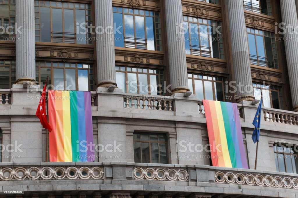 Building Balcony decorated with rainbow pride gay flag stock photo