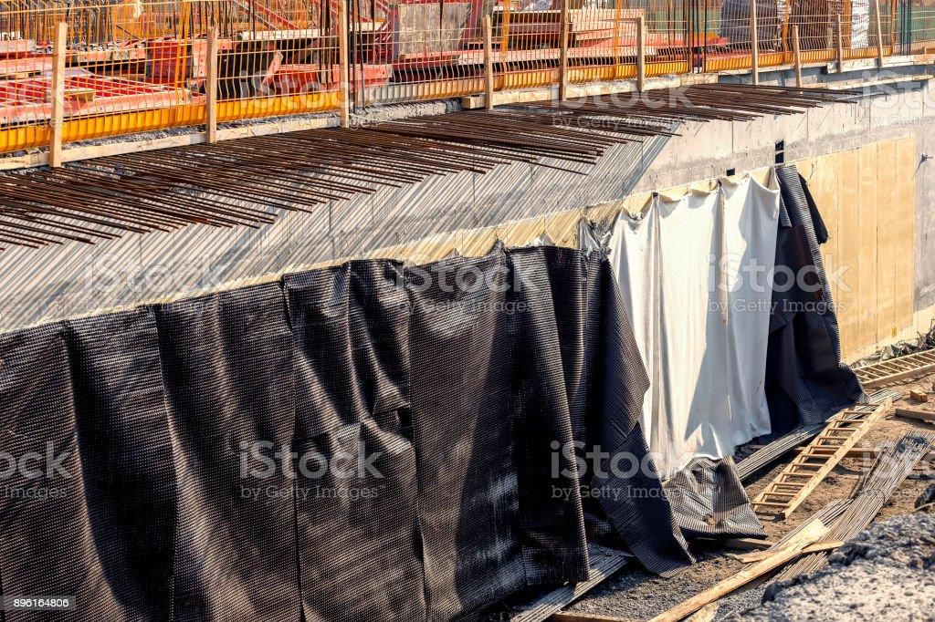 Building basement walls with waterproofing membrane stock photo