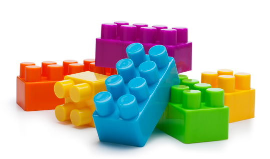 This is a photo of a building blocks isolated on a pure white background with a drop shadow. The focus is on the top of the front blocks and falls off a little bit on the back.Click on the links below to view lightboxes.